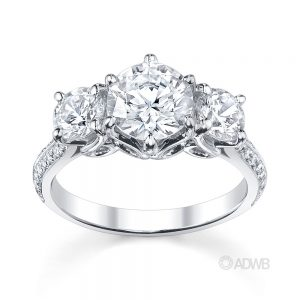 Australian Diamond Broker - Elegant 3 stone round brilliant cut diamond ring with knife edge grain set diamond band