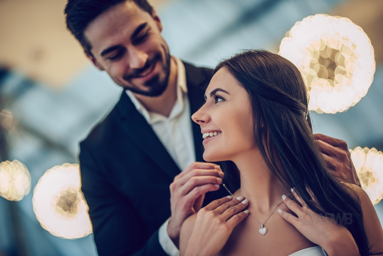man giving woman a necklace for anniversary